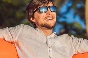 Summer lifestyle portrait of man