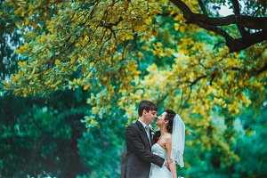 Groom and Bride in a park. wedding