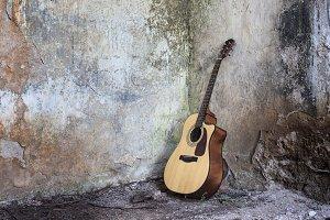 Guitar standing on the floor
