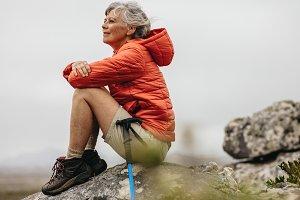 Female trekker sitting on a rock