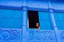 The girl looking from a window by  in People