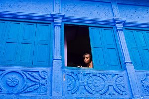 The girl looking from a window