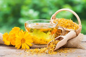 Cup of healthy marigold tea