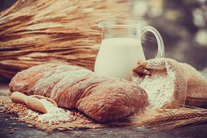 Fresh bread, jug of milk and flour