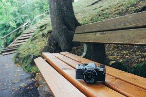 Film camera on bench in garden