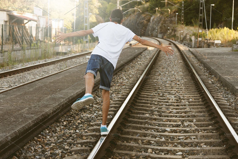 guy on the train tracks transportation photos creative market