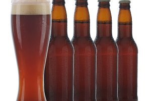 Four Brown Beer Bottles and Glass