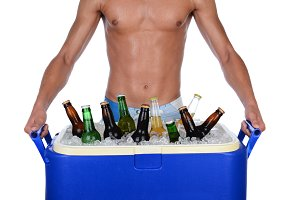 Young Man Carrying Beer Cooler