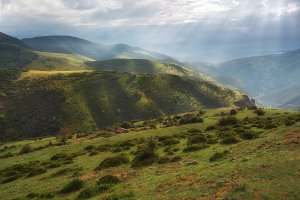 Valley landscape with rays of sunlig