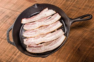 Cast iron skillet frying bacon