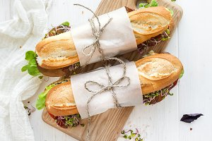 Sandwiches on a rustic wooden board