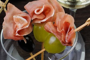 Hamon with grapes on a skewer