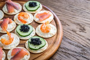 Canape with seafood on the board