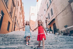 Adorable fashion little girls outdoo