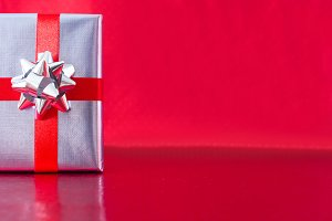 Silver gift box and red background