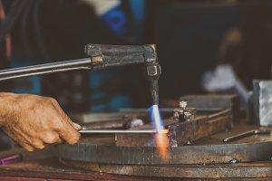 Closeup machinist hand bending the s