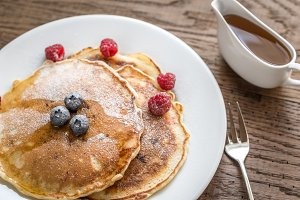 Pancakes with syrup and berries
