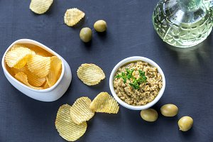 Potato chips with olive pate