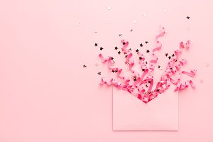 Party confetti explosion on pink