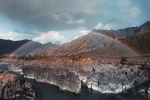 Double rainbow in autumn mountains