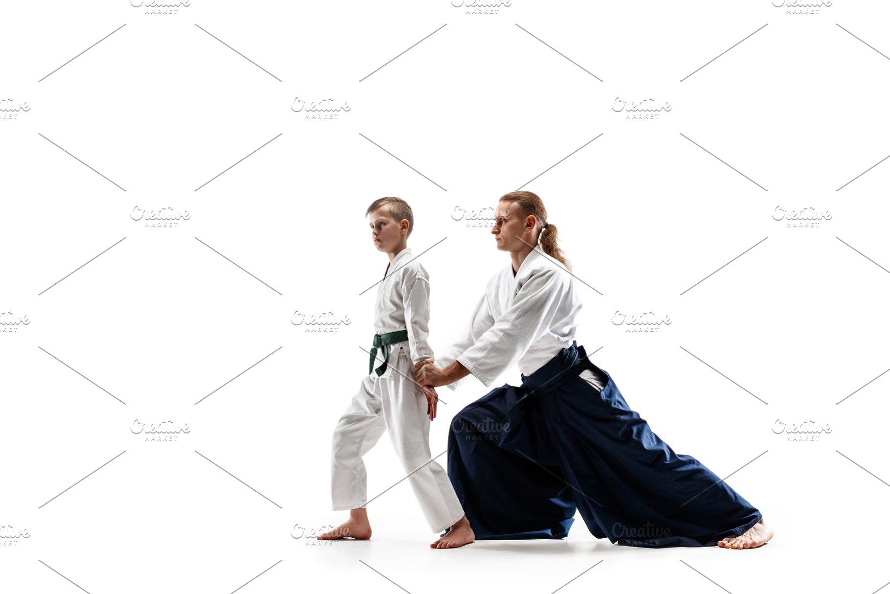 49a1b28ff65dd Man and teen boy fighting at aikido ~ Sports Photos ~ Creative Market