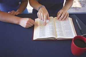 A Friend Helping Study the Bible