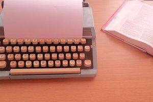 Vintage blue typewriter: study time