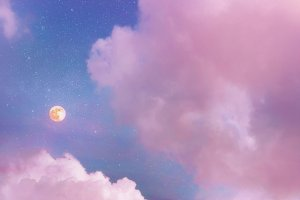 Pink sunset sky with moon and stars
