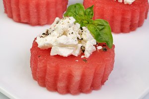 Appetizer of watermelon with ricotta