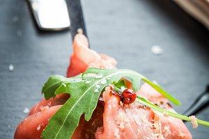 Meat carpaccio with parmesan