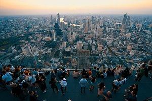 Tourists enjoy sunset on rooftop