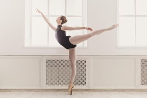 Beautiful ballerina in arabesque bal