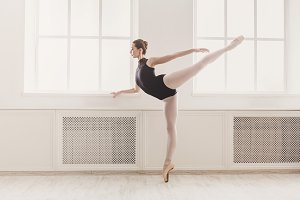 Beautiful ballerina in arabesque bal