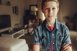 Close up of a boy standing at home