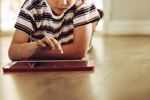 Kid playing games on a tablet pc