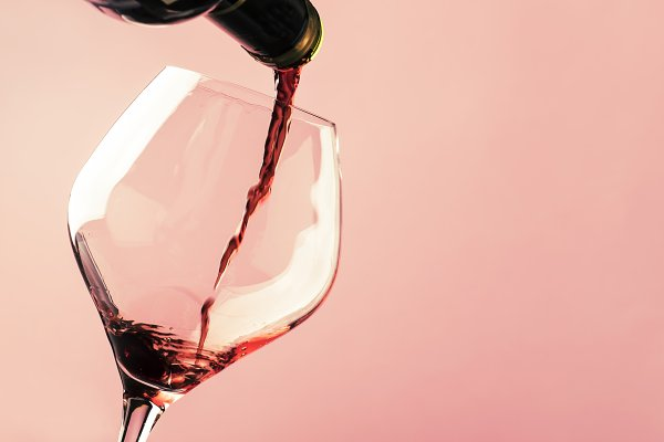 Stock Photos: 5PH - French dry red wine, pours into glas