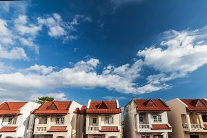 Clouds and sky with row of house