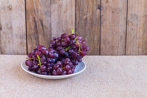 Red grapes on dish
