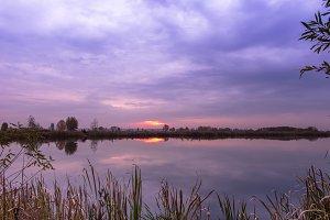 Sunrise over the lake. Reflection.