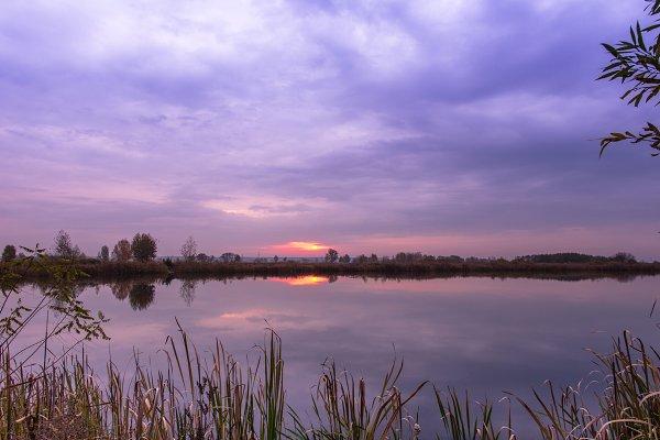Nature Stock Photos - Sunrise over the lake. Reflection.