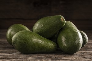 Ripe shiny avocados in heap
