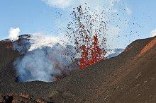 Red hot lava erupting from crater by  in Nature