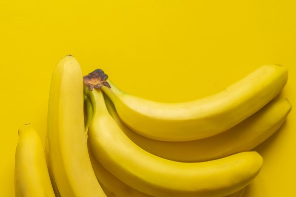 Stock Photos: Mikee's stuff - a bunch of bananas on yellow backgro