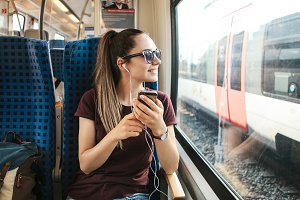 Girl listening to music on the train
