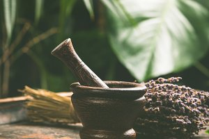 Mortar and pestle on tropical backgr