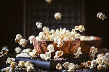 Salted popcorn in a wooden bowl, unh by  in Food & Drink