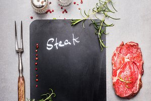 Chalkboard with raw beef steak