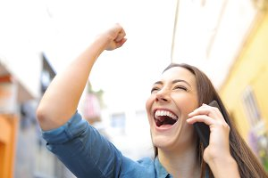 Excited woman receiving good news ta