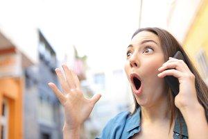 Surprised woman receiving good news