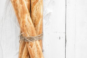 French baguettes on white table